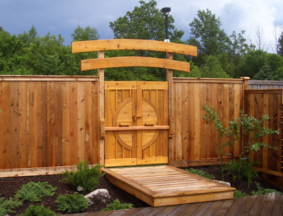 beautiful wooden teahouse gate and fence. Decorative shrubs and wooden ramp