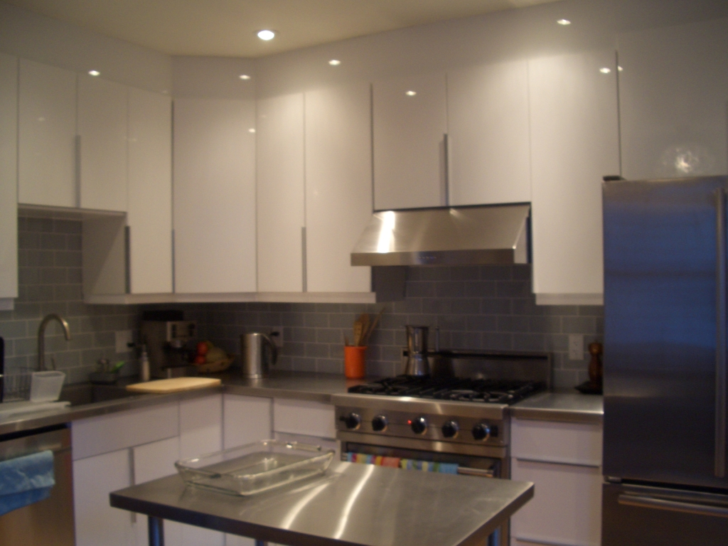 modern kitchen redesign large cabinets with added storage space, stainless steal appliances