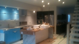 kitchen renovation partway complete. Added an island and marble surfaces.