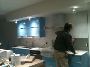 Halfway through a kitchen renovation. Pot lights to accentuate, extra cupboard space being added.